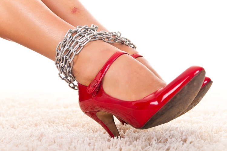violated women's legs with  bruise in chains, close up